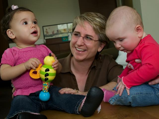 Infants with smiling researcher